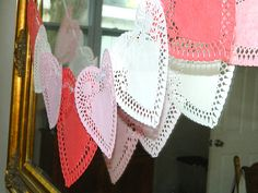 Simple garland made from heart shaped doilies.  From: http://www.decoist.com/2013-01-24/valentines-day-party-ideas-inspiration/