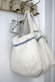 The Paper Mulberry: Rustic White Old rustic hooks. Sacs Tote Bags, Reusable Tote Bags, Paper Mulberry, Diy Sac, Grain Sack, Linen Bag, Linens And Lace, Rustic White, Fabric Bags