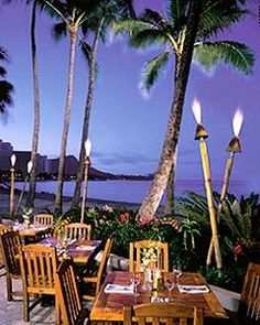 Oahu, Waikiki.  Dukes is a restaurant on the beach located inside one of the hotels. It is casual in that you cook your own steaks or chicken which really more fun than it sounds.  You can beat the scenery.  Food is good.  I have been here many times. Plus the boardwalk down the beach is right in front of you if you wanted to take a stroll.