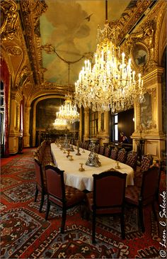 french royal palace dining room and chandeliersat louvre palace