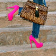 Everyone needs a pair of hot pink heels:)