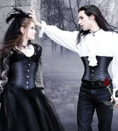 """Gothic lovers. ♥ - Dee: The vampire couple were still outside in deep conversation when I left the restaurant with the Amazonian guard. The slender male turned towards us as we were about to pass and said, """"Where are you going, lovely one?"""" he said pointing to me obviously not afraid of the amazon. After such a delicious meal at the restaurant, I wasn't in the mood for a fight so I raised my voice for the people in the plaza to hear, """"Greetings, young vampire, and goodnight. May there be…"""