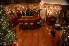 The second floor entertainment area with custom made rough cut bar.