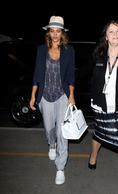 Jessica Alba looks chic even when at the airport: her sweatpants are not just plain and boring, her t-shirts are elevated with laid-back but stylish jackets and fun accessories like hats and fashionable sneakers. Check out all the times Jessica's travel style totally nailed it and get inspired to fly in style.