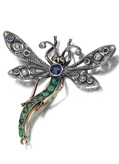 GEM-SET AND DIAMOND BROOCHES, CIRCA 1900. A brooch designed as a dragonfly set with circular-cut emeralds, sapphires and circular- and rose-cut diamonds.