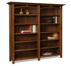 "Amish 74"" Artesa Bookcase The Artesa has 10 adjustable shelves. It's handcrafted by the Amish with solid wood. You can have it made doorless or with glass doors to shield contents. Select wood and stain and enjoy heirloom quality from DutchCrafters. #bookcases #officefurniture"