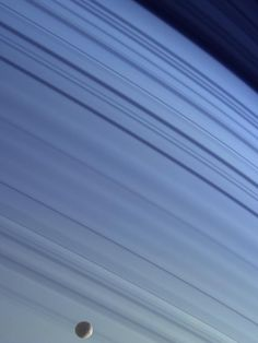 THE YEAR'S MOST AWESOME PHOTOS OF SPACE - June 30, 2014 - Mimas and Rings, Photos by NASA/JPL/Space Science Institute - http://www.wired.com/2014/12/best-photos-of-space-2014/