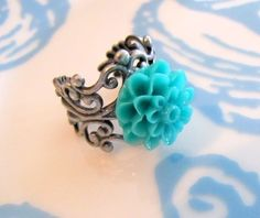 Love the vibrant teal and the metal detailing!