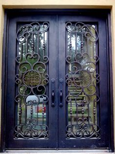 One of our favorite custom wrought iron entry doors .dream home. front doors. iron doors. wrought iron. exterior design. home remodel. home building. custom doors. curb appeal.