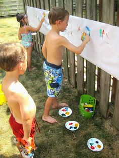 Finger Painting Mural Outside.  Have a simple kiddy pool nearby and you are golden.