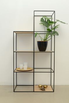 cube shelving unit is perfect for homes as well as retail displays. Achieve the same look with Abstracta Modular Displays 13mm system. visit www.abstracta.com to learn more.