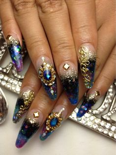 The art on these nails are gorgeous.....but I'd want them to be a normal length...not all witch-claw-ish.