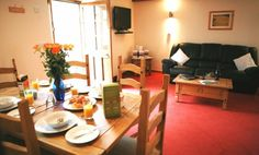 A traditional barn conversion cottage in Cornwall, Lamorna is set on one level and offers a cosy open plan living space with two double bedrooms and a twin Cornwall Cottages, Seaside Village, Falmouth, Breath Of Fresh Air, Double Bedroom, Open Plan Living, Living Spaces, Table Settings, Country