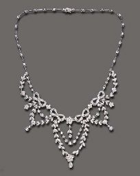 A DIAMOND NECKLACE  The front set with a series of circular-cut diamond ribbon bow and flower motifs, suspending similarly-set garland and diamond collet swags, each terminating in a diamond collet, joined to the diamond collet and knife-edged link back chain, mounted in 18k white gold, 18 ins.