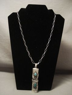 "This necklace contains a phenomenal pendant that is a very unique tube shape. The pendant measures around 2-3/4"" X 3/4"" not including the large bail. Located on the pendant are two accenting amazing Royston turquoise stones. 