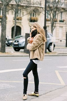 Black knit scarf, faux fur, distressed black skinny jeans, and gold oxfords.