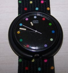 "Pop Swatch Watch -- these came out after the original swatch watches. You could ""pop"" out the watch face and change them up. The band was a woven stretch band."