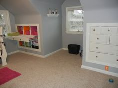 Knee wall storage idea.  If we could do it over, look at the pull-out changing table!!! WHOA!