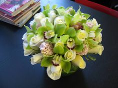 Looking for some added elegance? This #NYC fresh flower arrangement includes Green Orchid blooms, white Roses, and pink Hyacinths