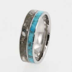 NOT as a wedding related ring but an interesting way to honor a pet.  Pet Jewelry / Memorial Ring / Titanium ring with Pet ashes and Turquoise - Patent Pending. $599.00, via Etsy.