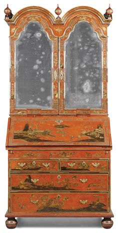 A Queen Anne scarlet, silvered and gilt japanned bureau cabinet, circa 1710.