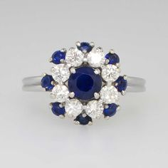 Retro 1.95ct t.w. Gorgeous Designer Velvet Blue Sapphire & Diamond Ring Platinum | Antique & Estate Jewelry | SOLD: 5/9/15 Jewelry Finds Price: $2500.00 A rich and velvety-blue diamond ring to wear as an alternate engagement ring, or stunning right hand ring! This platinum ring features a round brilliant cut natural blue sapphire (5.17mm and weighing approximately .67cts) surrounded by eight round brilliant cut diamonds