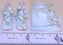 Pair of unworn antique Victorian era blue kid leather silk ribbon baby boots infant shoes date from 1900. They are made of a light baby blue soft kid leather, with pastel blue silk ribbon ruched gathered trim edging. These beautiful baby blue boots have silk ribbon ties for closure on the front, rounded toes and soft leather bottom soles. The shoes measure 3 inches tall, 5 inches long and 2 inches wide.