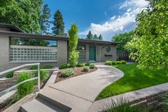 Mid-century modern located in Bonnie Brae with a stunning back yard | 3040 E Expostion Ave, Denver |