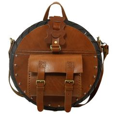 """Men's Leather Circular Satchel... """"circular?"""" Someone's scooter is missing a tire."""