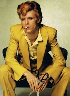 Bowie in yellow suit...with scissors...                                                                                                                                                                                 More