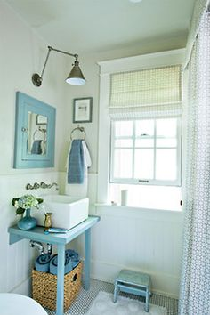 Make a small table into a bathroom sink vanity? Very cute!