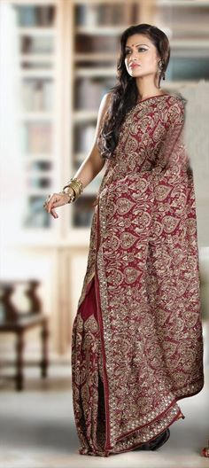 75260:Red and Maroon color family Saree with matching unstitched blouse; $263