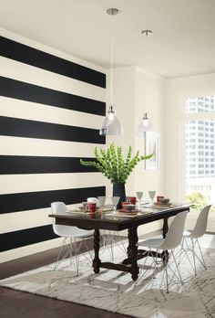 Use Sherwin-Williams' 2016 color of the year, Alabaster, in an unexpected way. Graphic black and ivory horizontal stripes bring drama to this dining room.
