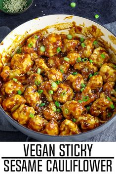 A large pan filled with prepared sticky sesame cauliflower. Topped with green onions and sesame seeds. Vegan Dinner Recipes, Vegan Dinners, Veggie Recipes, Whole Food Recipes, Cooking Recipes, Easy Cooking, Cooking Fish, Noodle Recipes, Dessert Recipes