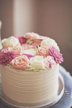Rustic buttercream cake with soft pink and cream rose flowers. by theresa