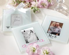 """There is a 38.00 Set Up Fee In Addition to the per piece cost of this item which will be automatically added to your cart when you select this item. Removing this charge in the shopping cart will result in cancellation of your order.Placing Orders: All orders for personalized glassware MUST be placed through our website. We will not accept personalization information on the telephone.Brides asked for it, and they're here! Our Personalized Frosted-Glass Photo Coaster Wedding Favors are the first photo coasters offered with screen printing directly on the glass. There's a reason everyone loves photo coasters so much to begin with: everyone enjoys getting creative with the photo slot! They can hold thank you notes, a place card, table numbers or pictures of the couple. Now you can have all the essence of a photo coaster and customize it too!Each frosted-glass photo coaster with padded """"feet"""" on the back to protect surfaces. Minimum order of 4 sets. Clear gift boxes with white satin bows available for an additional cost.This item is not eligible for free shipping promotions.Size: Photo coaster measures 3 1/2"""" square; Photo space is 2"""" h x 1 3/4"""" w"""