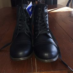 BRAND NEW BOOTS NWT Black combat boots 100% brand new never worn.. Say size 9 can definitely fit 9.5 because that's about my size.. Shoes Combat & Moto Boots