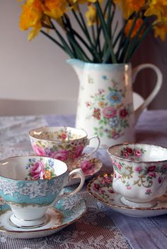 I love the mixture of florals on the cups and pitcher...lovely!