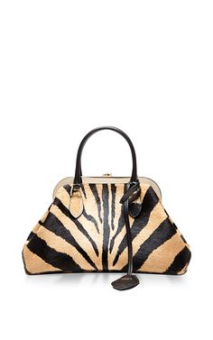 The iconic Parisian label **Rochas**, founded by Marcel Rochas at the age of 23, has since blossomed into a coveted collection of ready-to-wear and finely crafted accessories. This medium-sized handbag impresses with its sleek animal print calf hair, exaggerated shape and optional shoulder strap—suitably refined embellishments for a luxurious accessory.