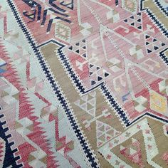 Oh so pretty in #pink! Many #vintage #kilims are bold, bright colors, but you come across washed or soft tones like this piece as well. Almost all vintage Turkish kilims were made by women in their homes in villages across Turkey. That's also why they tend to be smaller than grand-sized workshop rugs; they couldn't fit a 10' loom in their house! #rugs #turkishrugs #ruglife #handmade #textiles @urbanamericana