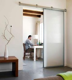 Industrial-Inspired Sliding Door - looking for the hardware to try this too!