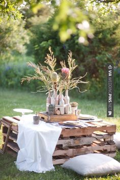 Picnic Pallet Tables scattered though out the reception  Table runner - Black sequin Flowers - Native Glitter Jar vases & Candles