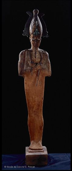 Statue of Osiris. Ptolemaic Period, 332-330 BC. This stuccoed wooden statue depicts the famous god Osiris, lord of the dead, who was assassinated by his brother Seth and resurrected by his sister and wife, Isis. The god is portrayed in his usual iconographic pose: standing, his body wrapped in a mummy-shaped sheath, wearing the atef crown and holding the crook and flail scepters, which could also by carried by pharaohs. Taken from the gallery of the Louvre Museum in Paris.