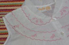 White muslin with embroidery trim?!?!  OR machine decorative stitch edging