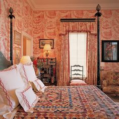 Rosy toile bedroom with lots of pattern
