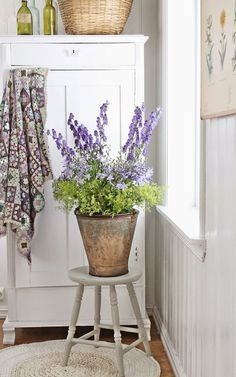 Inspiring combination of flowers in a vintage bucket.