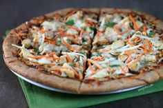 This Thai Chicken Pizza uses the most delicious PB2 peanut sauce! Only 205 calories or 5 Weight Watchers point per slice. www.emilybites.com #healthy
