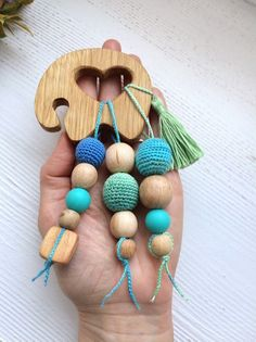 This wooden teether elephant toy is perfect for baby from 5 month till 1 year old. The green tail is make like a tassel.