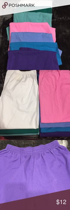 Bundle of 7 Scrub Pants All in great condition, two pockets on sides, one pair has elastic on the legs, 7 colors, White, light blue, hunter green, hot pink, purple, light green, teal. Pants Straight Leg