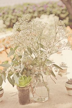 I love the succulents and the baby's breath for a summer inexpensive wedding centerpiece #Weddings #WeddingCenterpieces